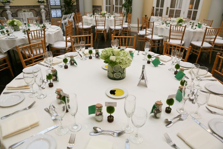 """Our colors were mainly off white and different shades of green,"" says Jennifer We wanted a feeling of freshness, life, and renewal. We used a lot of white and green hydrangea with sliced lime circles for the centerpieces."""