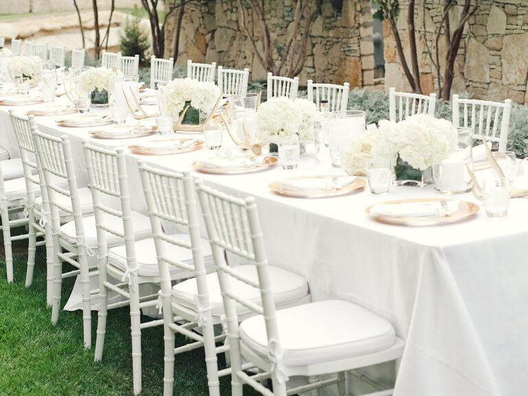 Elegant white family-style reception table