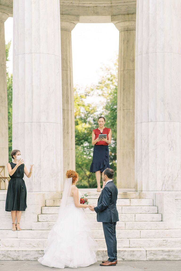 Couple exchanging vows at Washington D.C. War Memorial