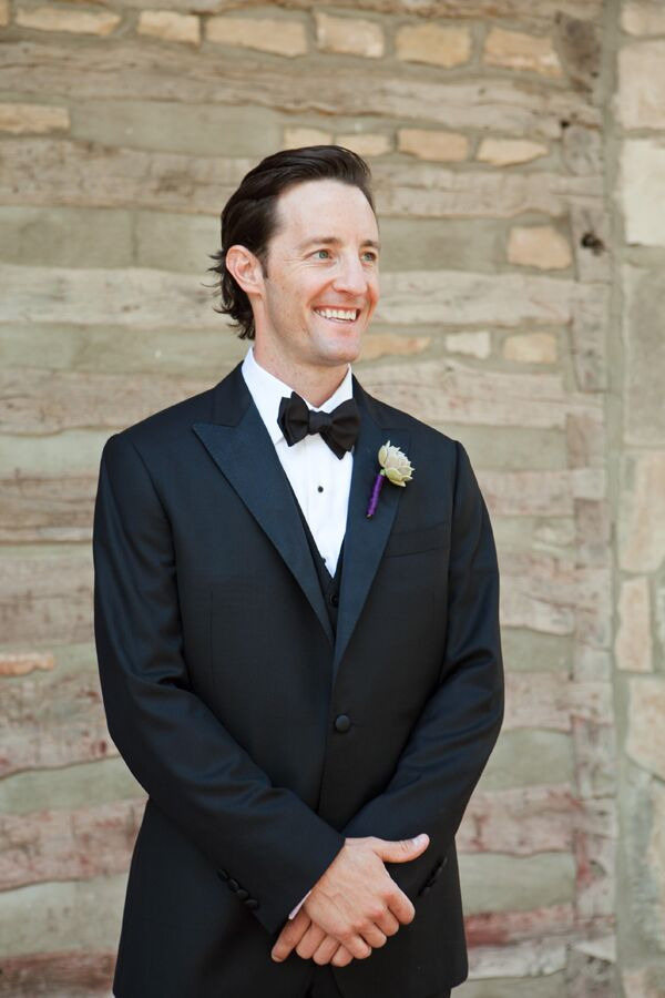 Brand wore a custom traditional black tuxedo and custom black cowboy boots. The boutonnieres were succulents with plum-wrapped stems.