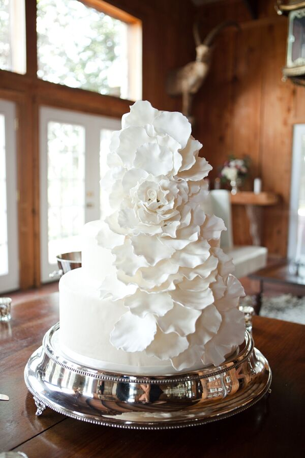 The couple had a beautiful four tier cake with a cascade of fondant petals down one side. Since the groom does not like cake, the couple also had a pie table with pies from Koffee Kup Family Restaurant in Hico.