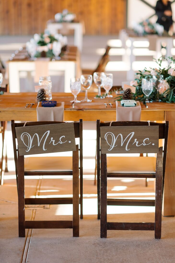 """Rustic accents included wooden signs embellished with calligraphy, from the seating chart to the """"Mrs."""" signs that adorned the newlyweds' dining chairs."""