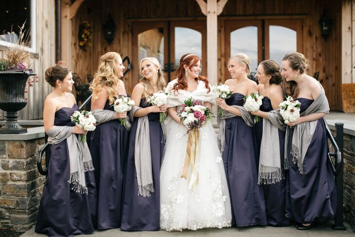 Amanda's bridesmaids wore strapless, floor-length dresses in purple and gray stoles.