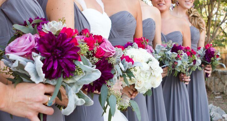 The bridesmaids carried bouquets of plum dahlias, amnesia roses, raspberry spray roses and succulents.