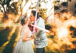 Couple Shares Kiss While Holding Star Wars Light Sabers