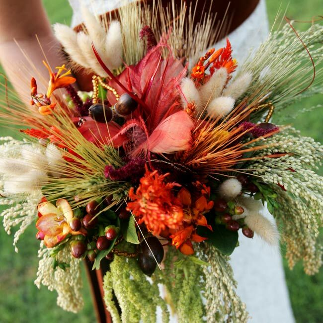 """""""I had this idea of mixing fresh flowers and dried flowers together,"""" Tatiana says. Her florist took the idea and ran with it, incorporating beads and feathers into the bouquets and arrangements as well as the mix of blooms."""