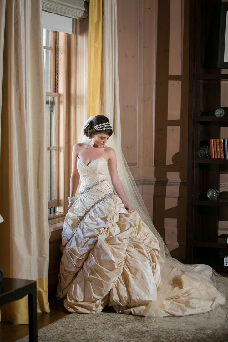 """""""I found an incredible headpiece with crystals and pearls and a cathedral-length buttercream veil, which was very simple with just a thin trim of satin ribbon,"""" says Nicole."""