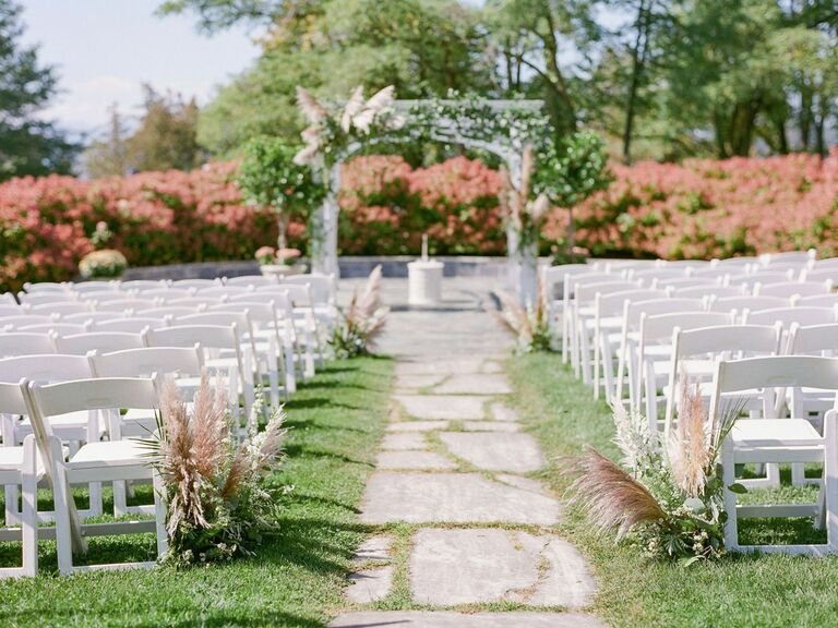 Wedding ceremony aisle with pampas grass decorations
