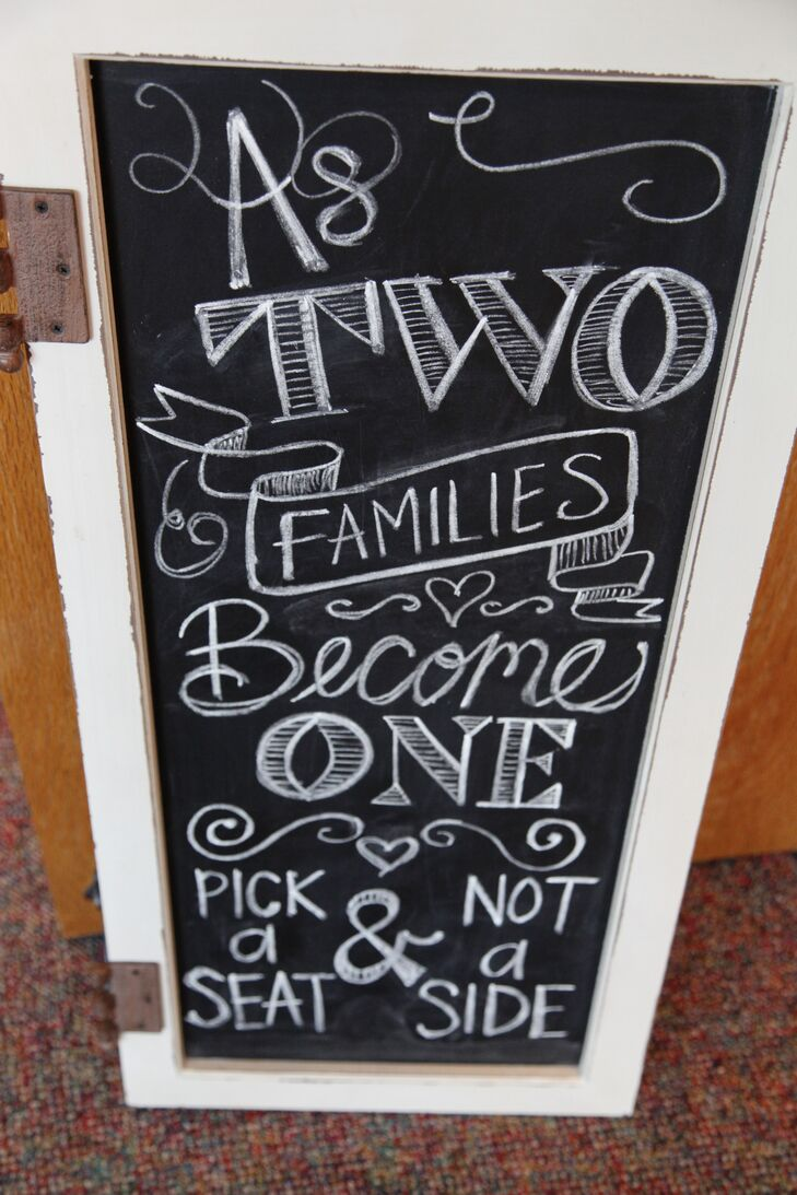 With the help of a rustic chalkboard sign, the couple encouraged their family and friends to mix and mingle during the ceremony.