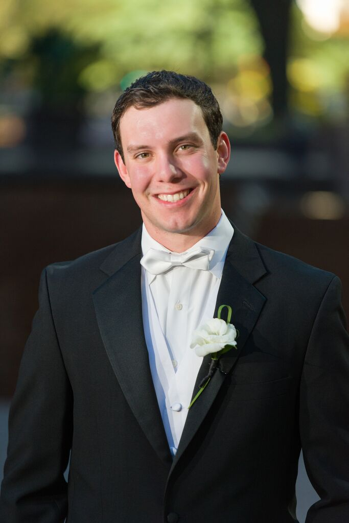 Jonathan wore a black tuxedo with a white shirt and white bow tie for the wedding.