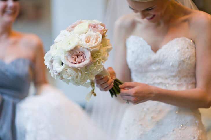 Allison carried a bouquet of garden roses, ranunculus, roses, hydrangea and anemones in shades of white, blush and mauve.