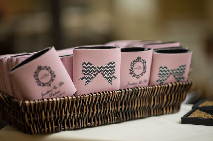The couple gave each of their guests a custom koozie in pink or gray as their wedding favor. The couple's monogram incorporated their first and last initials.