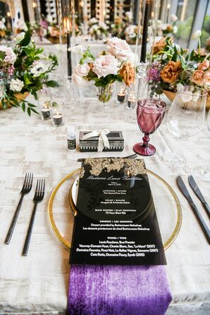 Place Setting With Black Menu Cards and Purple Water Goblets