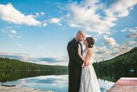 Christin Verkaik (29, a Graphic Designer) and Eben Smith (29, a US Navy Electrician) held their gorgeous summertime wedding at Camp Roosevelt in Maine
