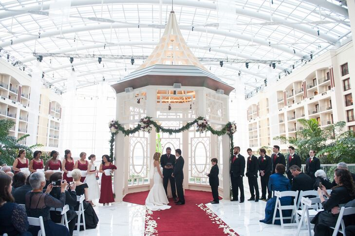 The ceremony was held under the gazebo at Gaylord Convention Center. The gazebo was decorated with garlands and the red aisle was lined with white rose petals for the event. The ceremony was officiated by James' uncle, and Francesca and James opted to read both traditional vows and vows that they wrote themselves.