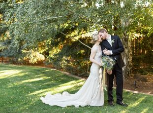 Acres and acres of grassland surrounded by foliage and redwood trees created an enchanted, private ambience for the already-intimate backyard wedding,
