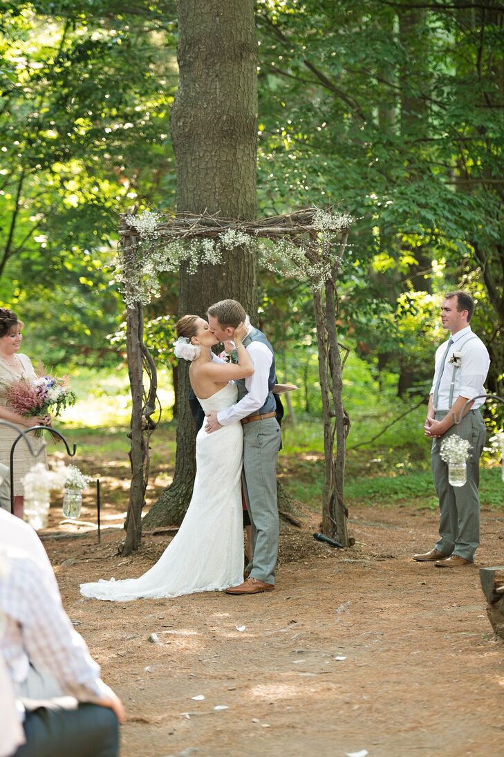 Katie and Rob were married under a wooden arch that was decorated with baby's breath.