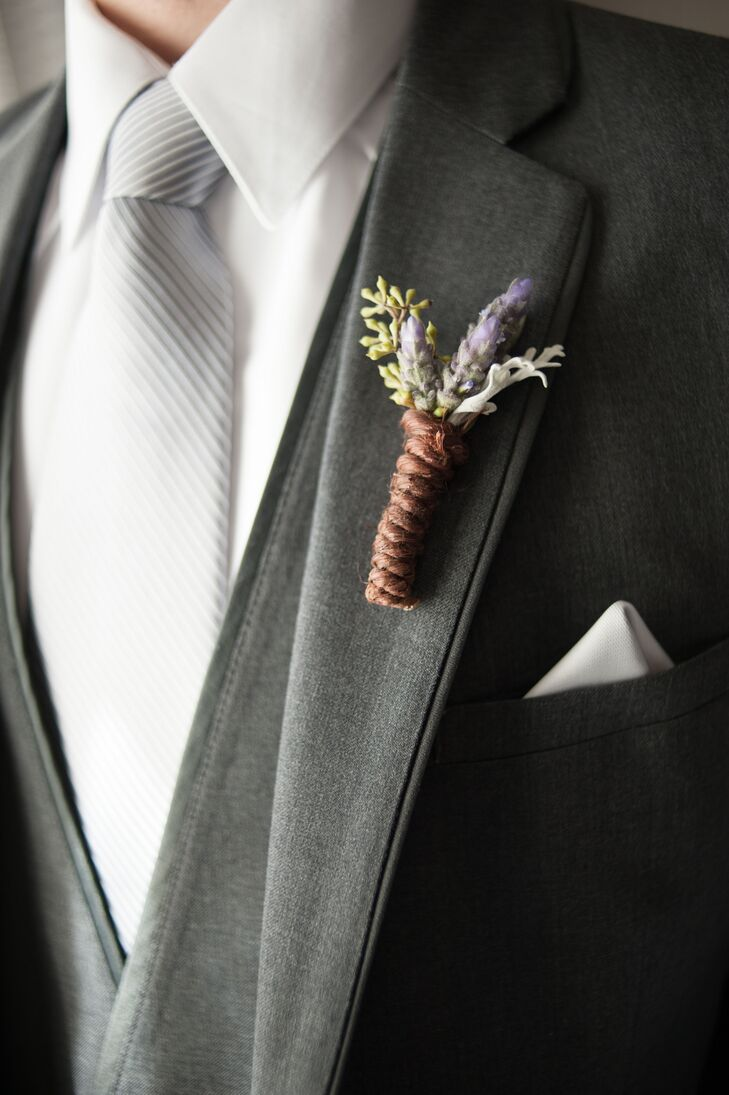 Mike pinned a lavender boutonniere to his charcoal gray suit. He also wore a silver tie and a silver pocket square.
