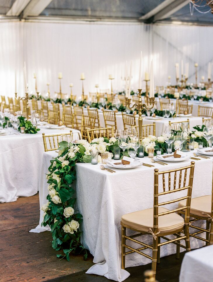 Glamorous Tented Reception with Gold Chiavari Chairs and Greenery Runner