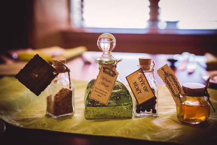 "Whimsical bottles filled with Hogwarts ""potions"" provided colorful decor on the Hogwarts-themed dining tables."