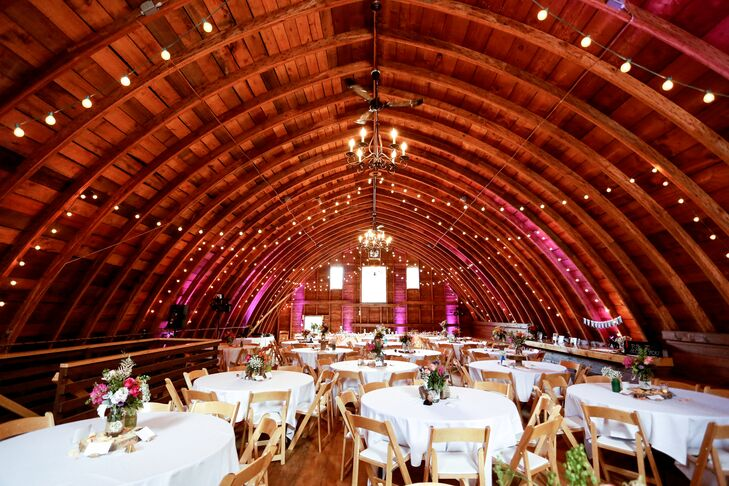 The White Barn Loft, with its tall ceilings and hardwood floors, was perfect for Katie and Jon's reception at Rum River Vineyard in Hillman, Minnesota. The original hay loft had the rustic charm aura they wanted, and the string lights and chandeliers added plenty of romance.