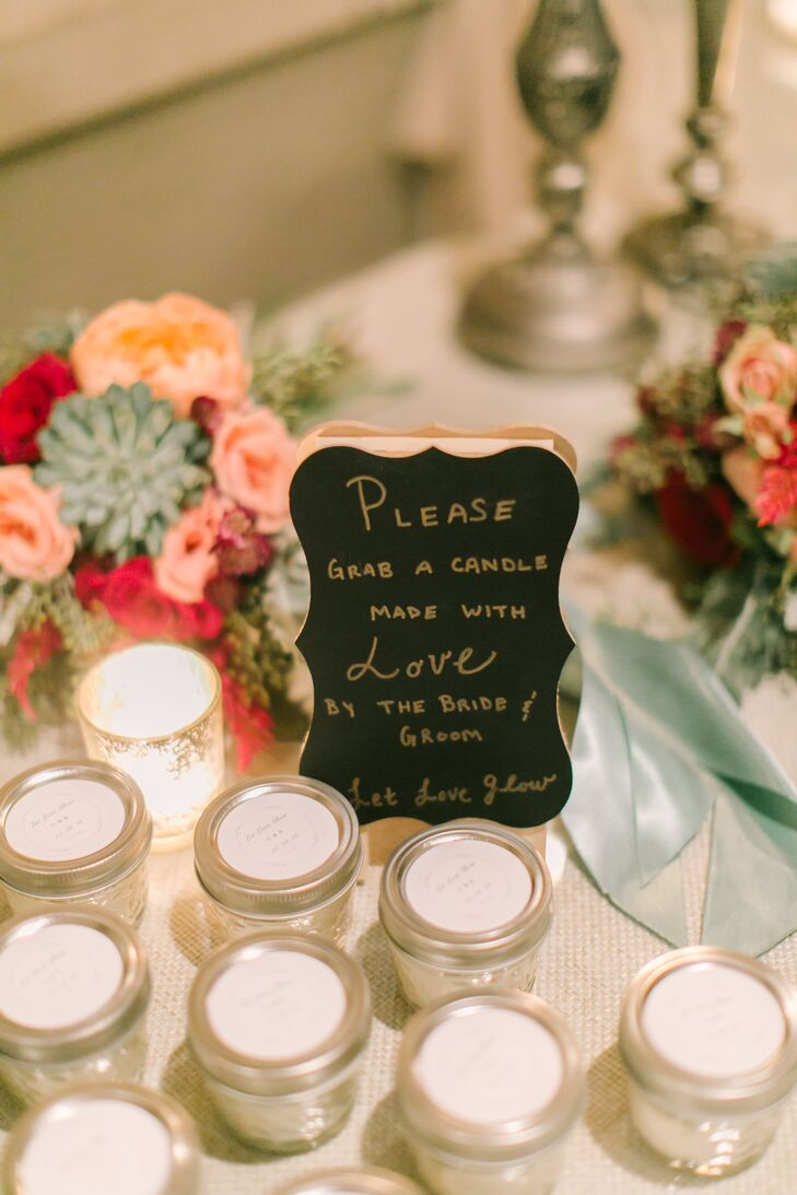 "Stefanie and Christopher's favors were a true labor of love. They gave each guest a homemade cinnamon candle, labeling each mini mason jar with a sticker that read ""Let love glow."" ""It was a lot of work to make over 100 candles, but we had fun doing it together,"" Stefanie says."