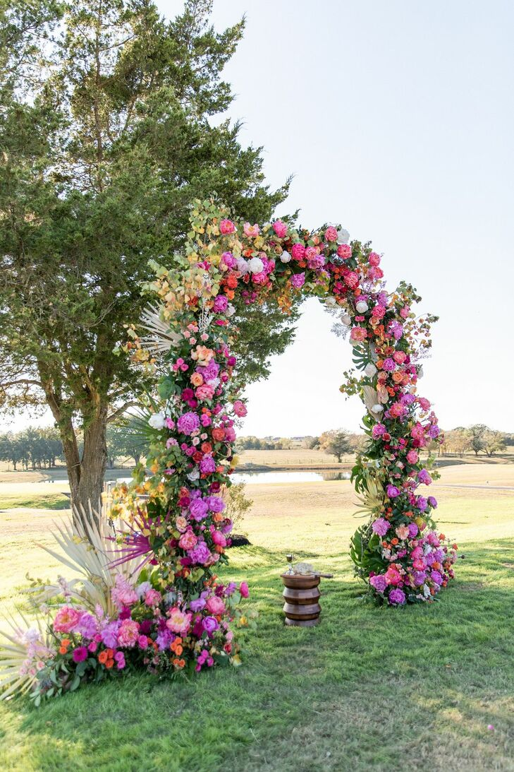 Whimsical Pink Wedding Arch with Ranunculus, Peonies and Garden Roses