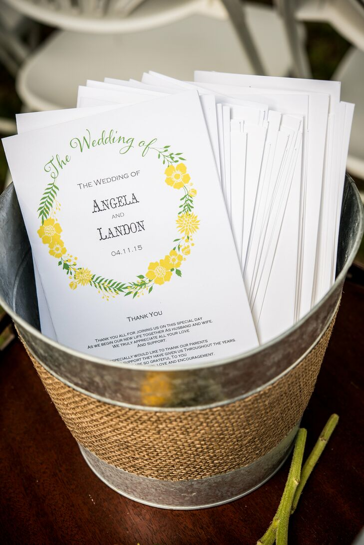 """After some searching on Minted, Angela and Landon picked out stationery that felt like springtime. """"It really worked wonderfully with our theme,"""" Angela says. The programs alone included a wreath of yellow petunias and olive leaves with their names at the center."""