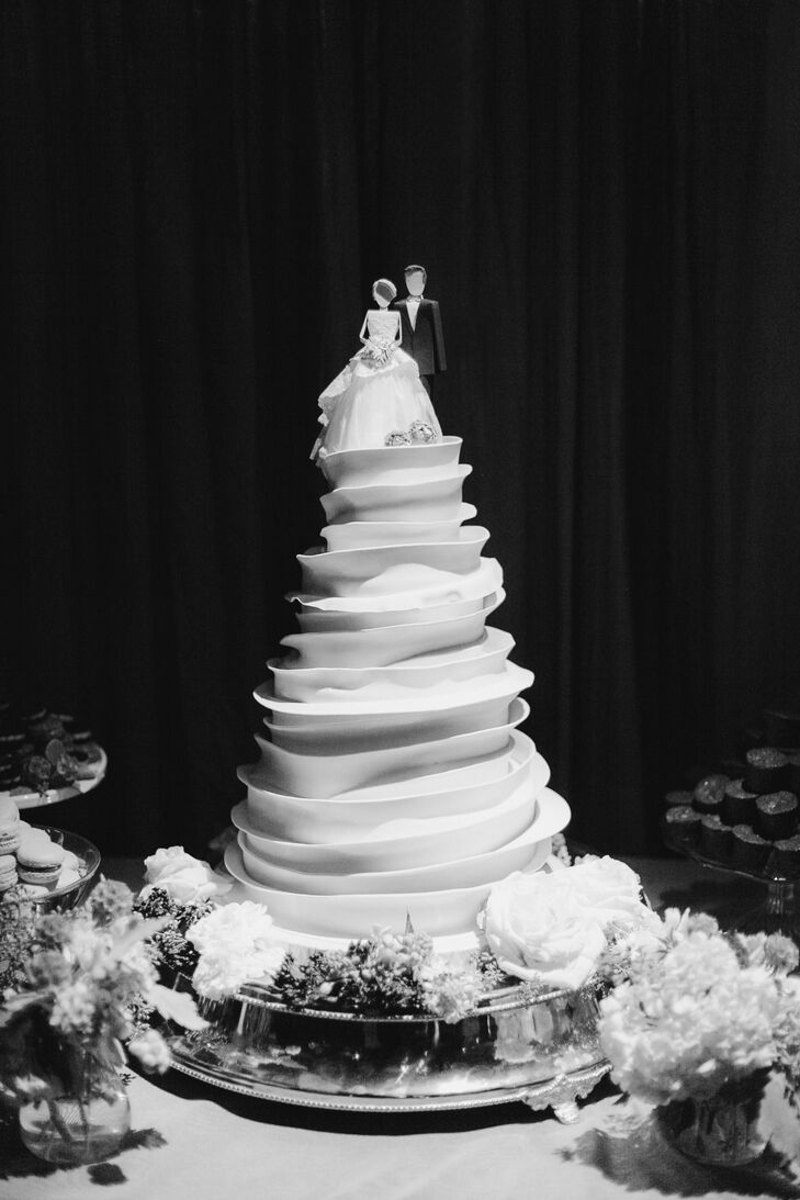 Layers of swirling fondant gave the wedding cake the look of a light, airy cloud.