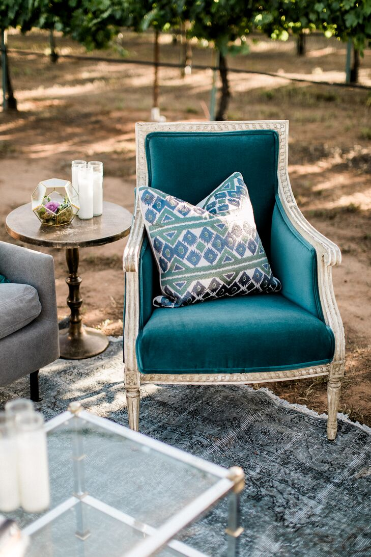 Turquoise Velvet Chair with Printed Pillow
