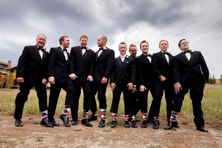Chris stood out from the rest of his groomsmen in an ivory bow tie.  To honor his favorite sports team, the Denver Broncos, all of the groomsmen wore matching orange and blue, Broncos themed argyle socks.