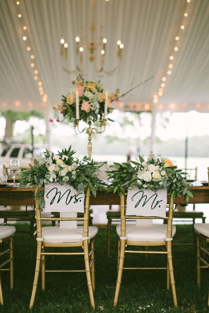 Lights, chandeliers and a stunning oversized farm head table warmed the tented reception.