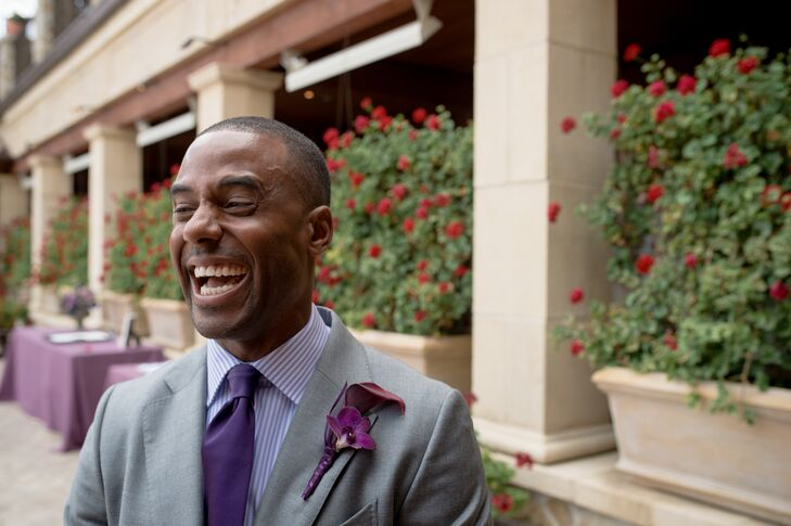 Doug had a purple calla lily and purple orchid boutonniere pinned to the lapel of his light gray custom-made suit. The boutonniere matched his dark purple tie and purple-and-white-striped dress shirt, along with the many other purple accents seen throughout the wedding day.