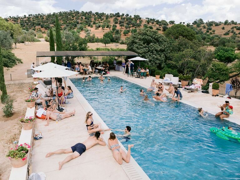 Pool party at summer wedding in Spain