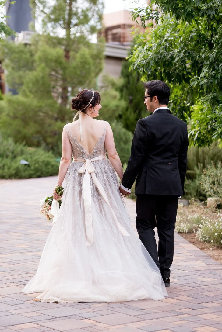 Anna customized her wedding gown by adding a long ribbon around the waist.