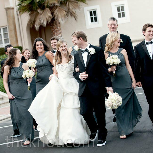 All eight bridesmaids paired elegant charcoal-gray floor-length dresses with sandals, while the guys wore classic black tuxes with sneakers.
