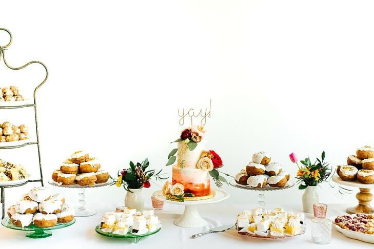 Whimsical Dessert Table with Cake and Doughnuts