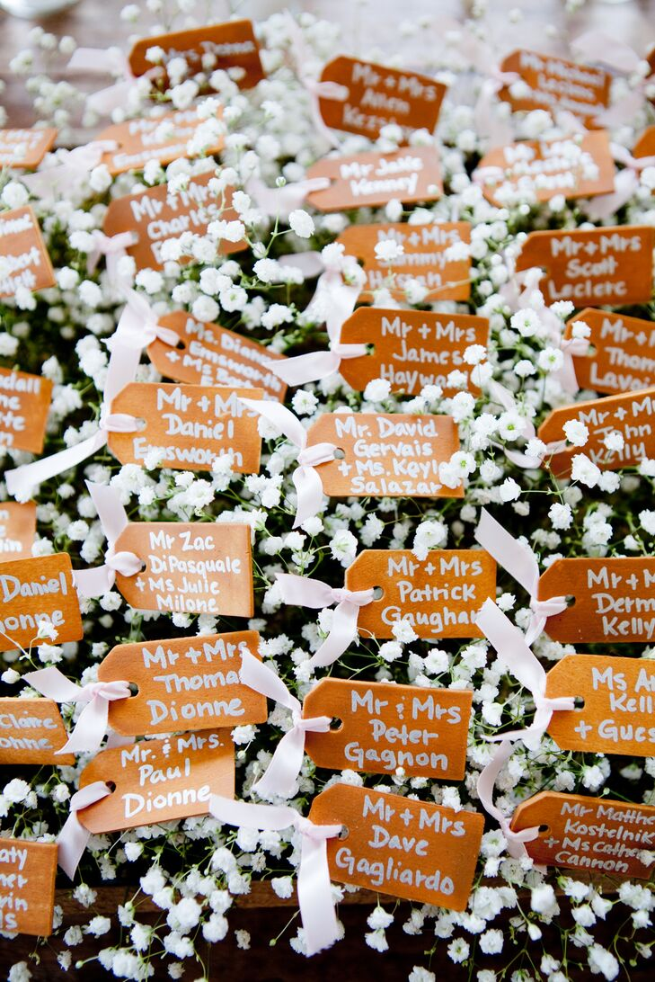 Their escort card display looked like a flower field. Each wooden card was placed on top of bunches upon bunches of baby's breath and tied with light pink ribbon.