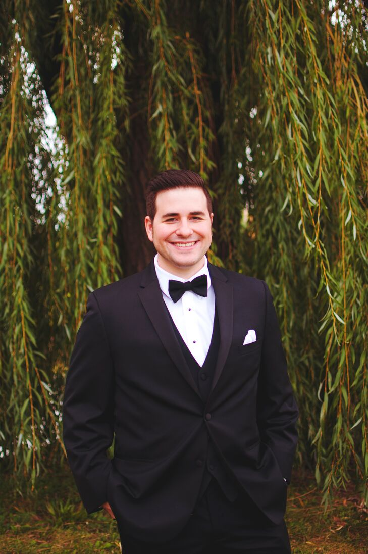 Tom and his groomsmen kept things classic in black suits paired with satin bow ties.