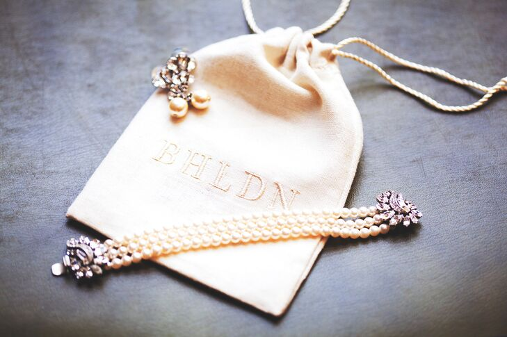 A simple, pearl bracelet from BHLDN completed Ashley's glam wedding day look.