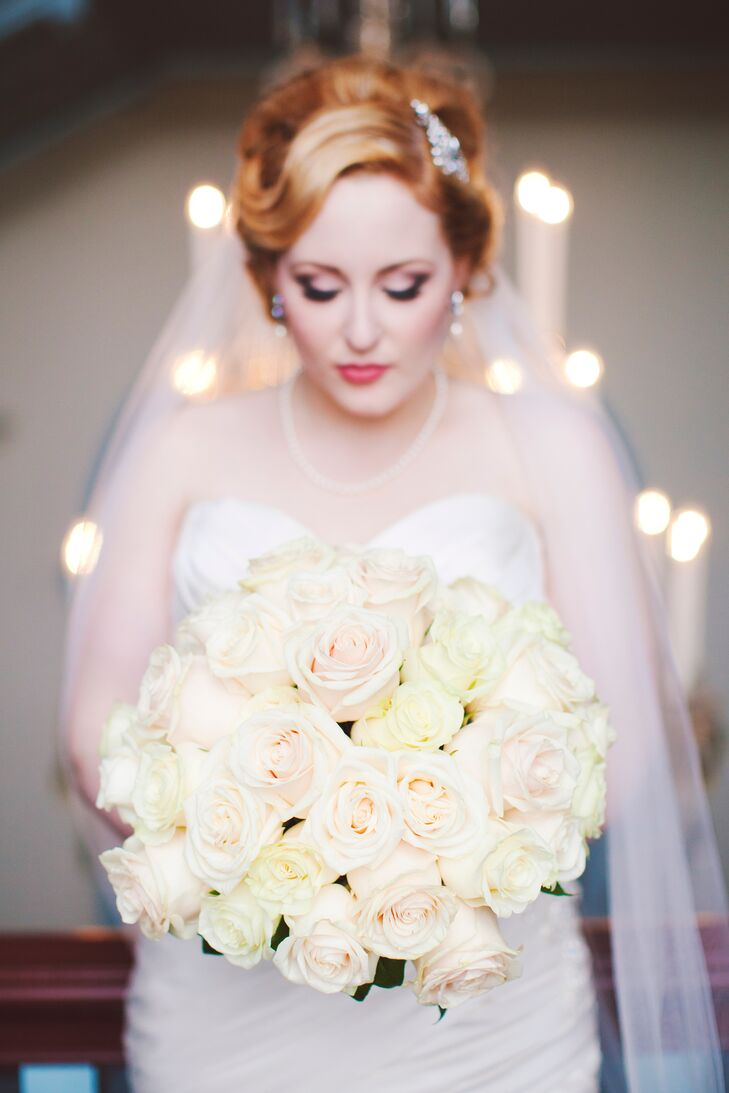 Inspired by their palette of soft blush and gold, the bride kept her bouquet simple thanks to blush and cream-colored roses.