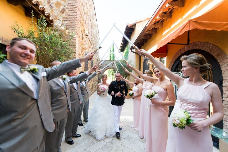 Each bridesmaid wore a blush floor-length dress from David's Bridal in different styles for the wedding. The groomsmen wore gray suits from Men's Warehouse with white shirts and suspenders.