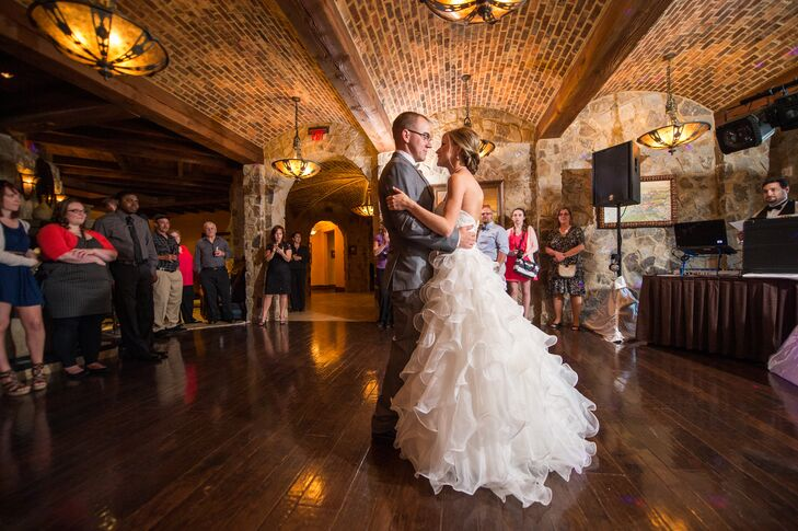 The couple took their first dance surrounded by 50 friends and family members.