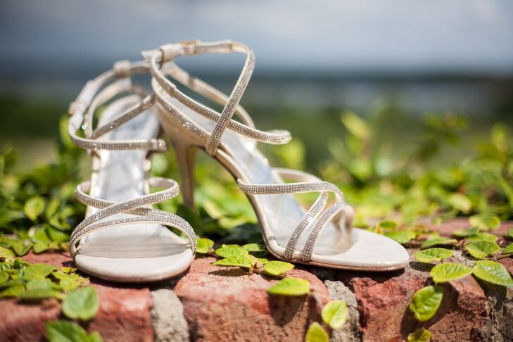 "While she had originally envisioned wearing flats on her wedding day, lora chose a pair of rhinestone accented ivory heels she found while shopping with Michael. ""Michael, who is never one to comment on fashion, noted that the shoes were gorgeous and I felt compelled to buy them and wear them for our wedding,"" says Lora."