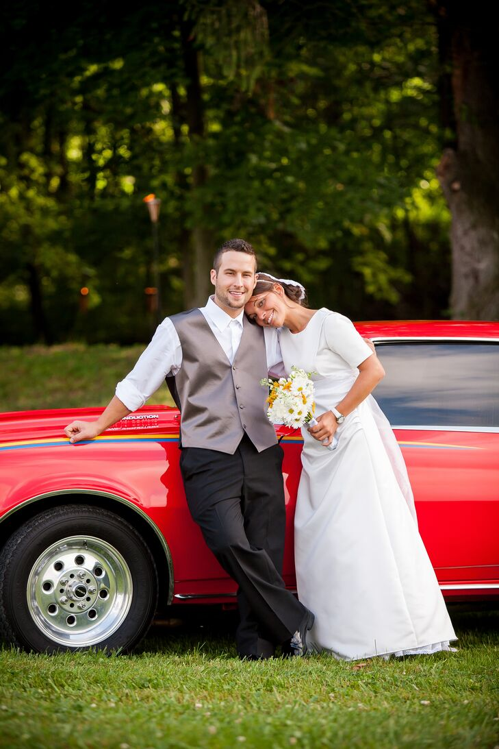 LeAnna wore a a sophisticated 3/4 sleeve, sheath, satin wedding dress that gathered at one side. She and Matthew drove to and from the ceremony in style--in a vintage 1968 red Camaro!