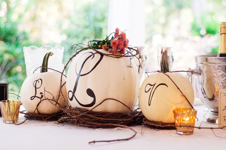 The October wedding was accented with in-season flowers and pumpkins in blue and white.