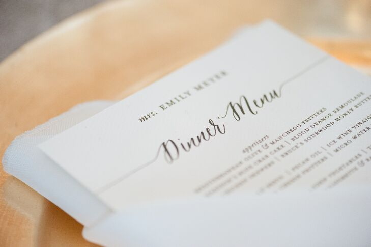 """Paper Daisies Stationery created the timeless black-and-white dinner menus for the reception at Old Edwards Inn and Spa in Highlands, North Carolina. Each menu was topped with a guest's name, so they doubled as place cards. """"I wanted it to feel very intentional and personalized for every guest,"""" Emily says."""