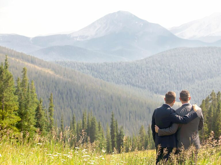 Two grooms on mountainside in Colorado