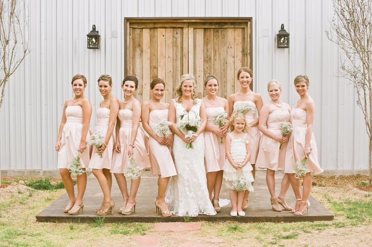 The bridesmaids wore a petal pink and carried baby's breath bouquets.