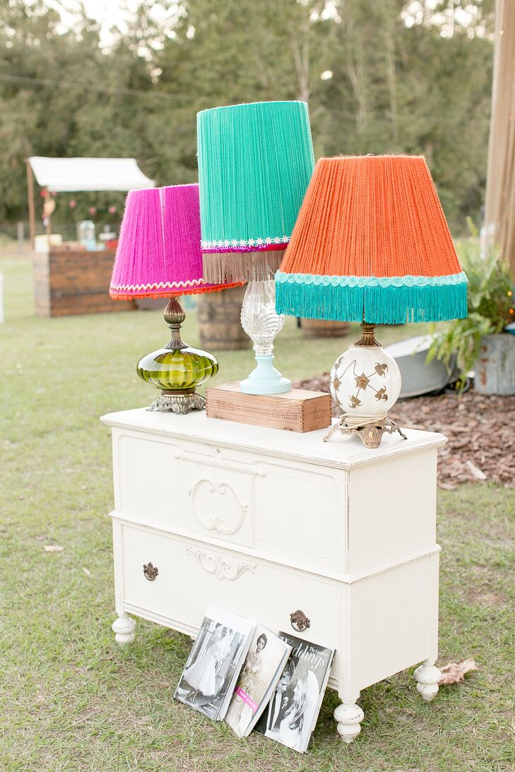 "These vintage-style lampshades were DIY! With just yarn, fringe and ribbon, Katie made every one herself. The bold pink, blue and orange colors even matched their other decor. ""They were the perfect finish to our bright-colored lounge,"" she says."
